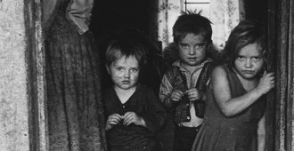 Black and white image of three children photographed by Jack Corn