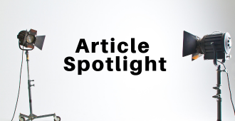 Photo of two spotlights turned on the words article spotlight