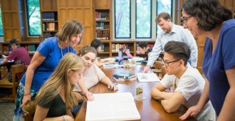 Librarians help students in the reading room