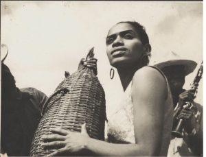 Delia Zapata Olivella holds tall basket