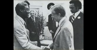 Rev. Kelly Miller Smth shakes hands with President Jimmy Carter